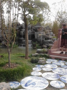 Jiangxi province mini-garden, with stones leading to the bridge as its famous Jingdezhen blue-and white porcelain.