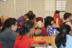 Participants listening to a challenge question presentation.