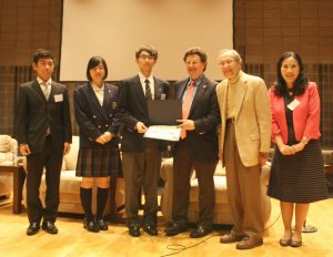 Dr. Perry and Dr. Potter congratulate participants from Soka Senior High School with Masako Toki, CIF project manager