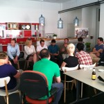 Crowd listening to Thomas Vassen of The HUB Amsterdam talk about Village Capital.