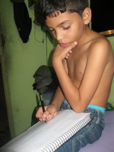 Working hard- Dieguito fully concentrated on his homework.