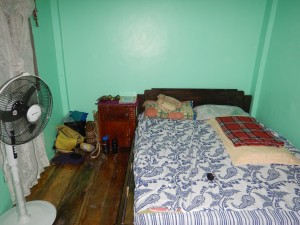 My room is bright! Wooden floors and a nice big bed.