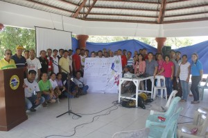 """Picture! Picture!"" -- group photo with the participants and tarpaulin."