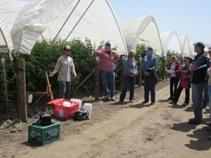 Michael Johnson of the Resource Conservation District demonstrates various tools for assisting growers with irrigation fertilization evaluations.