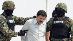 "Mexican drug trafficker Joaquin Guzman Loera aka ""el Chapo Guzman"" (C), is escorted by marines as he is presented to the press on February 22, 2014 in Mexico City. The Sinaloa cartel leader - the most wanted by US and Mexican anti-drug agencies - was arrested early this morning by Mexican marines at a resort in Mazatlan, northern Mexico. AFP PHOTO/Alfredo Estrella (Photo credit should read ALFREDO ESTRELLA/AFP/Getty Images)"