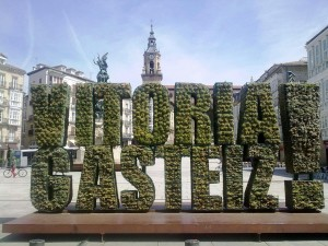 Hometown. Vitoria-Gasteiz is where I live. It is the capital city of the Basque Country and in 2012 it was awarded as the European Green Capital. This monument made of shrubbery was designed to represent the award and it stands in the center of the city.
